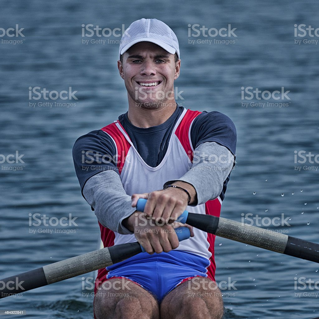 Rowing competitor in action stock photo