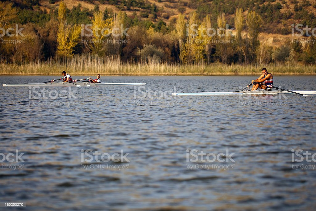 Rowing competitors have a rest at the training. stock photo