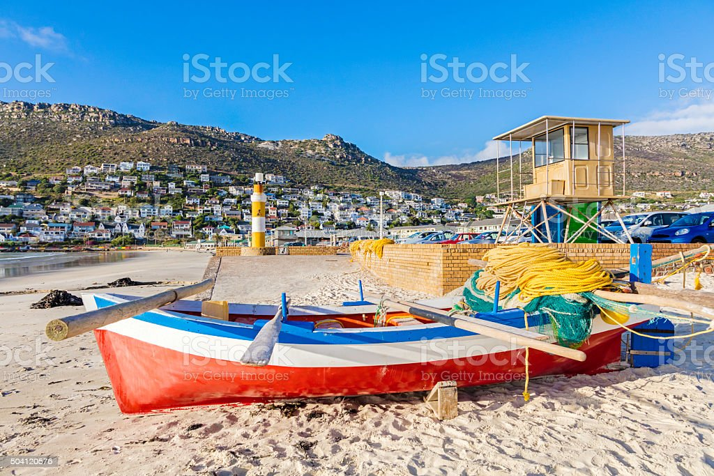 Rowing fishing boat on the beach stock photo