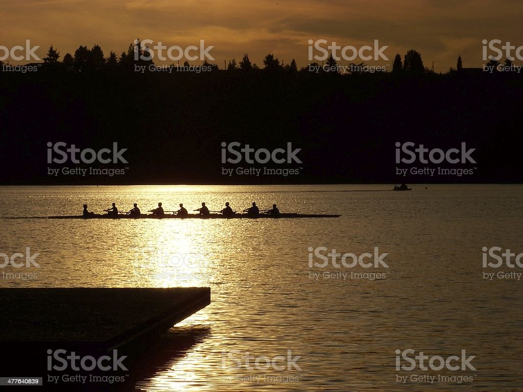 Rowing in the sunset stock photo