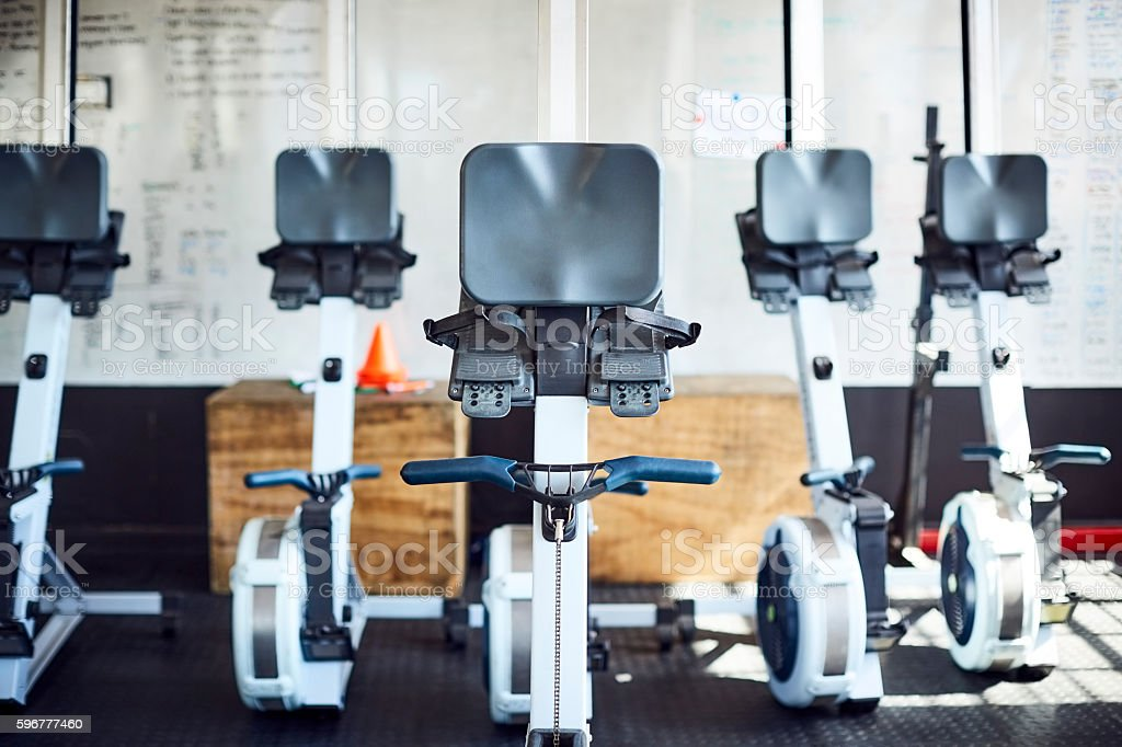 Rowing machines in gym stock photo