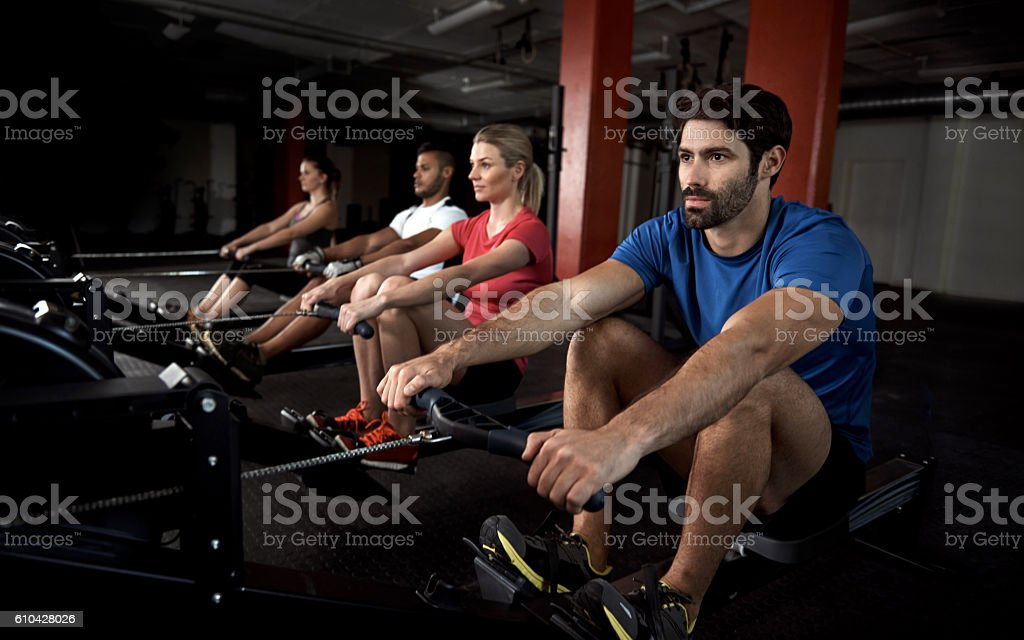 Rowing machines minimize back strain and maximize tone stock photo