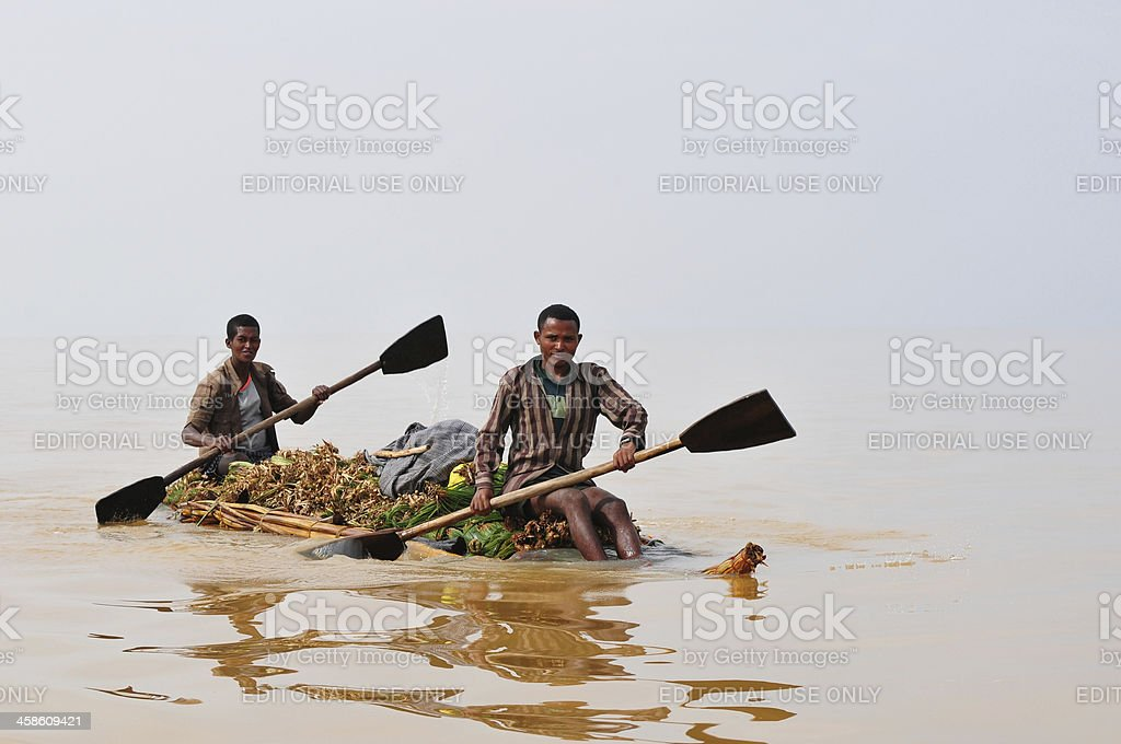 Rowing on African lake stock photo