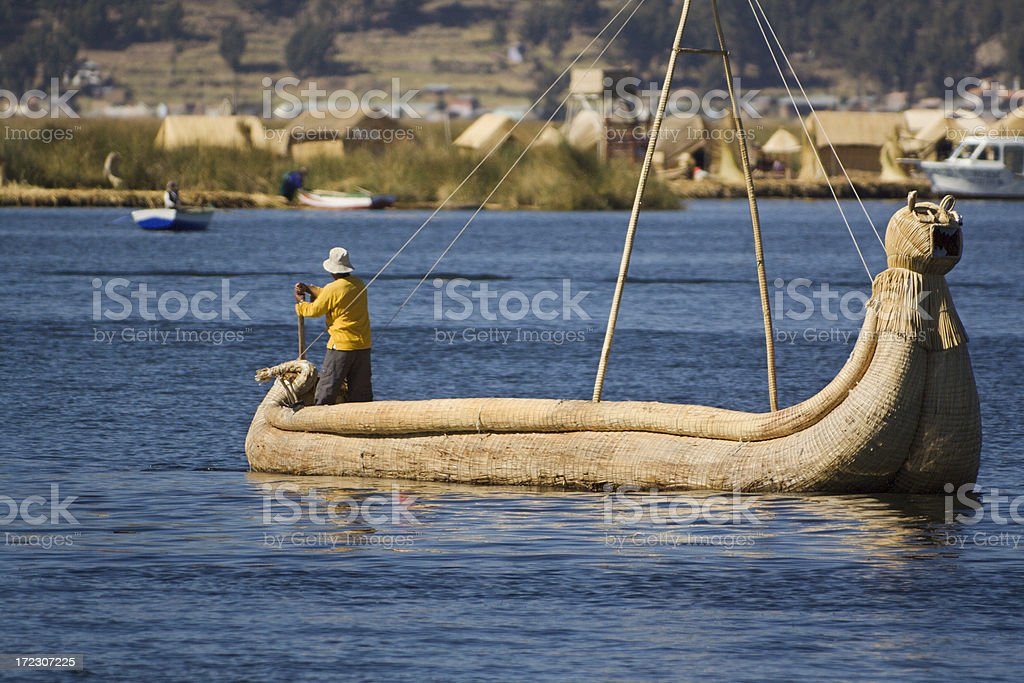 Rowing Reed Boat on Lake Titicaca royalty-free stock photo