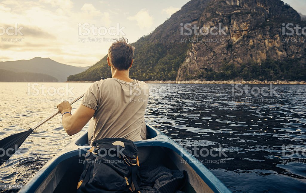Rowing to the back of the lake and beyond stock photo