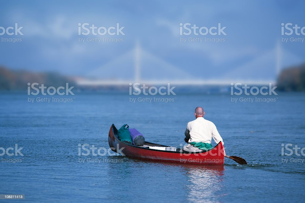 rowing towards the bridge stock photo