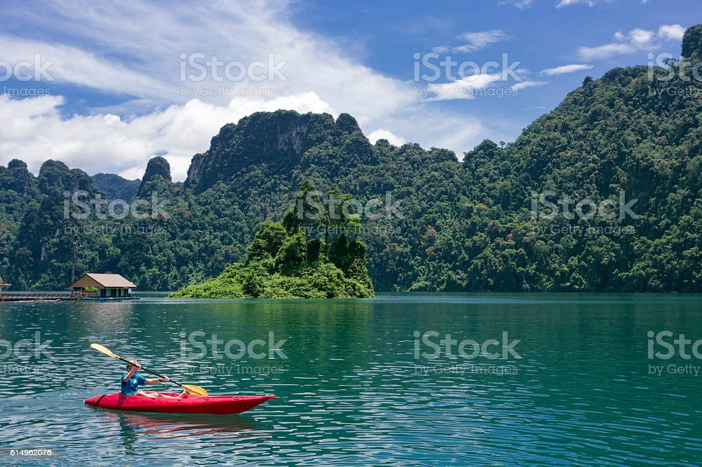 Rowing with a kayak in Kao Sok National Park lake stock photo