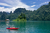 Rowing with a kayak in Kao Sok National Park lake