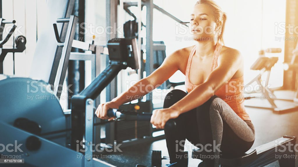 Rowing workout at gym. stock photo