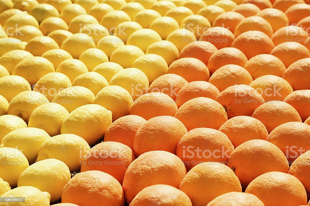 rows lemons and oranges on the market royalty-free stock photo