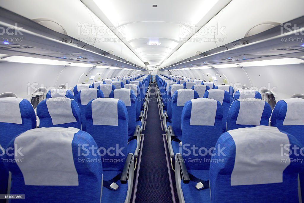 Rows of blue and white seats on an airplane stock photo