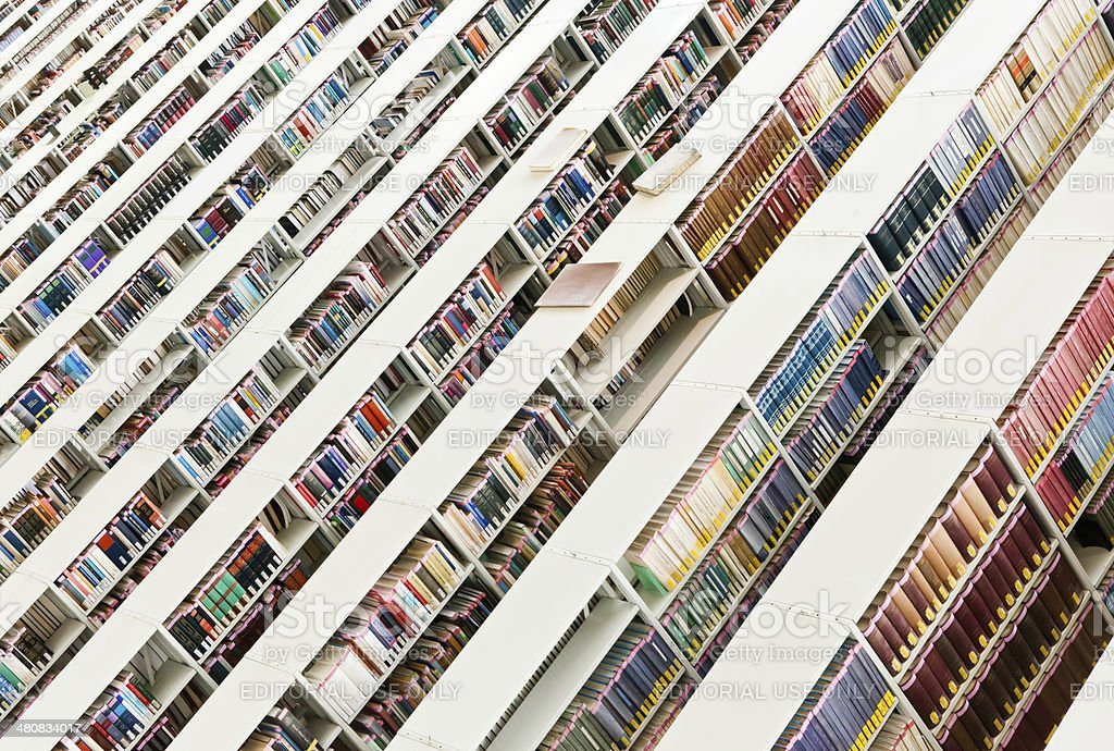 Rows of books in a public library royalty-free stock photo