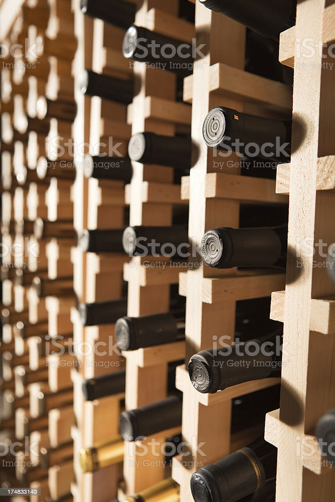 Rows of Bottles in a Full Wine Rack Vertical royalty-free stock photo