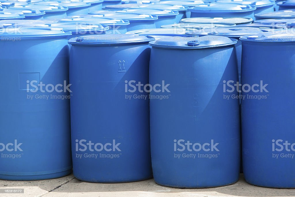 Rows of bright blue, unlabeled barrels royalty-free stock photo