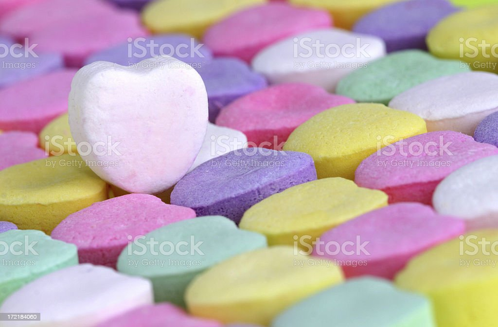 Rows of candy hearts with a white heart on top royalty-free stock photo
