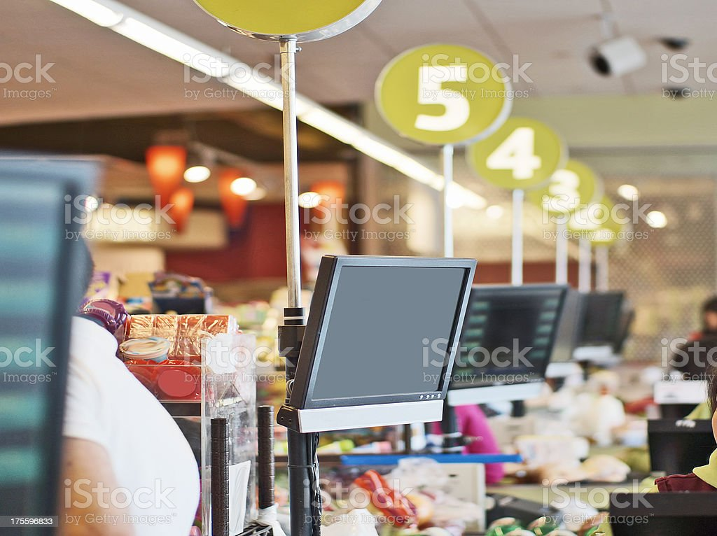 Rows of cashier checkout lanes at a store stock photo