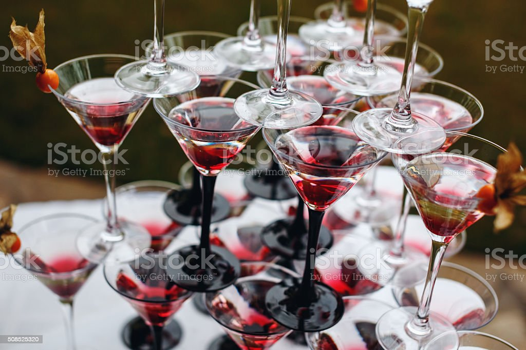 Rows of Champagne Glasses with Color Cocktails stock photo