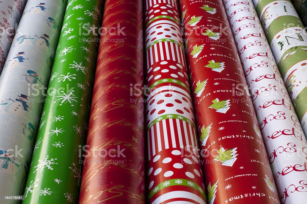 Rows of Christmas wrapping paper stock photo