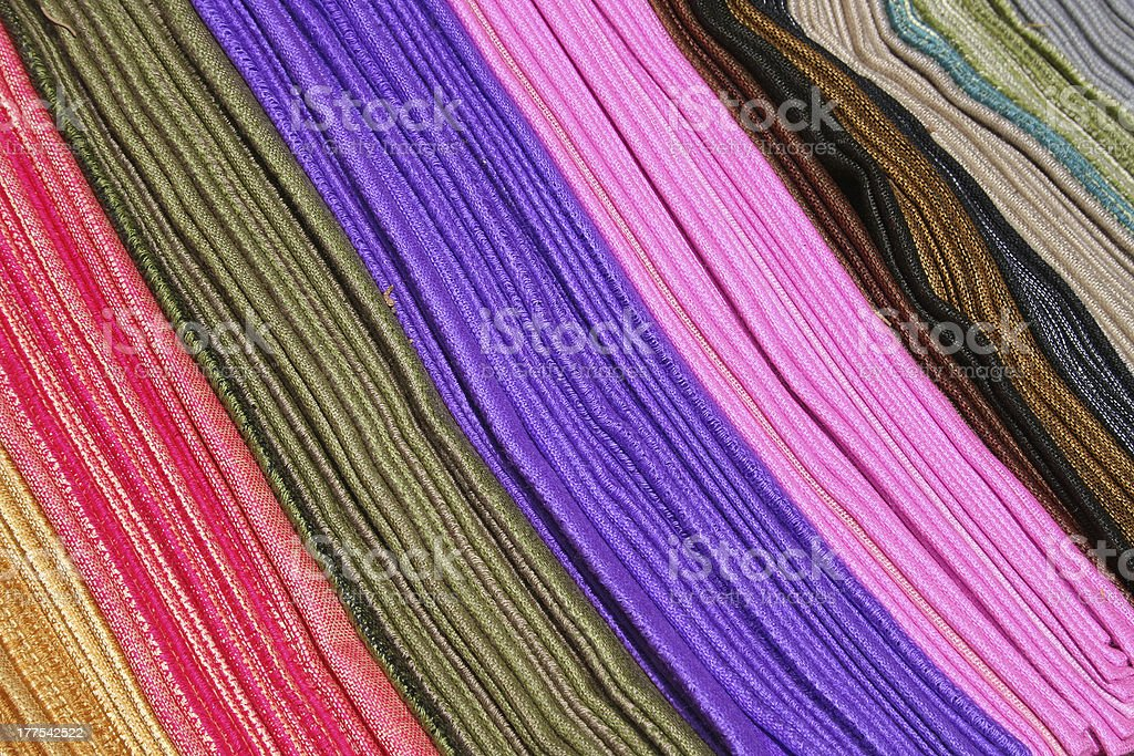 Rows of Colored Scarves at the Otavalo Market stock photo