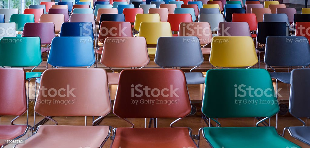Rows of colorful chairs stock photo