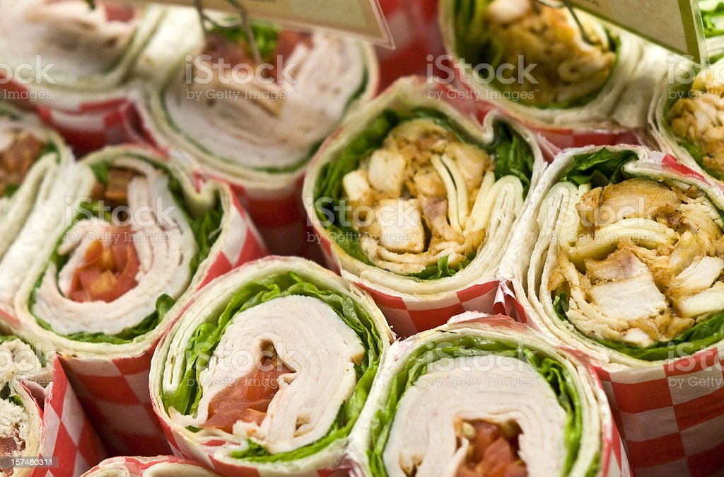 Rows of deli wrap sandwiches with various fillings royalty-free stock photo