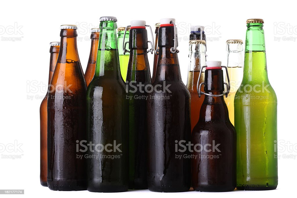 Rows of different color beer bottles stock photo