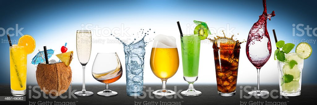 Rows of different drinks all on a black table stock photo