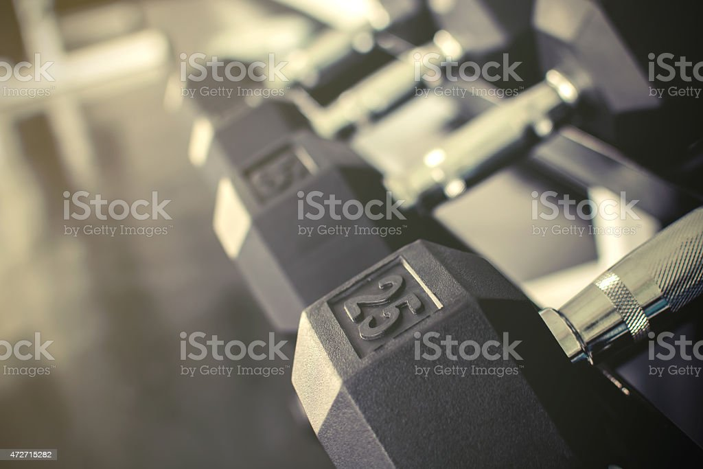 Rows of dumbbells on a rack stock photo