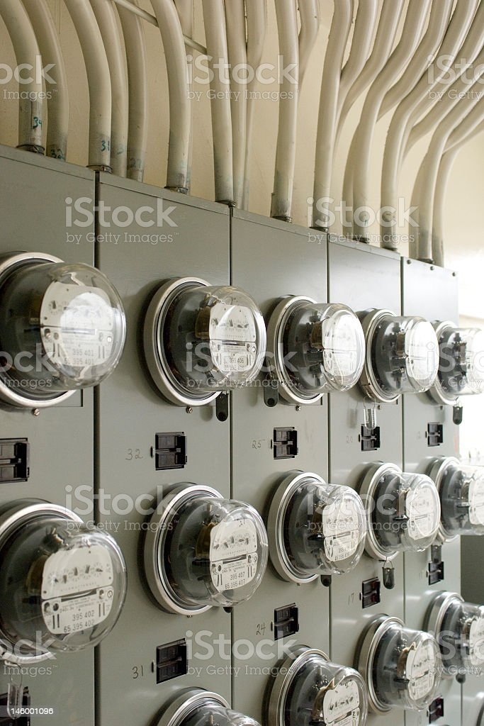 Rows of electricity meters on silver panels stock photo