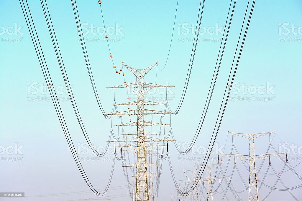 Rows of electricity pylons stock photo