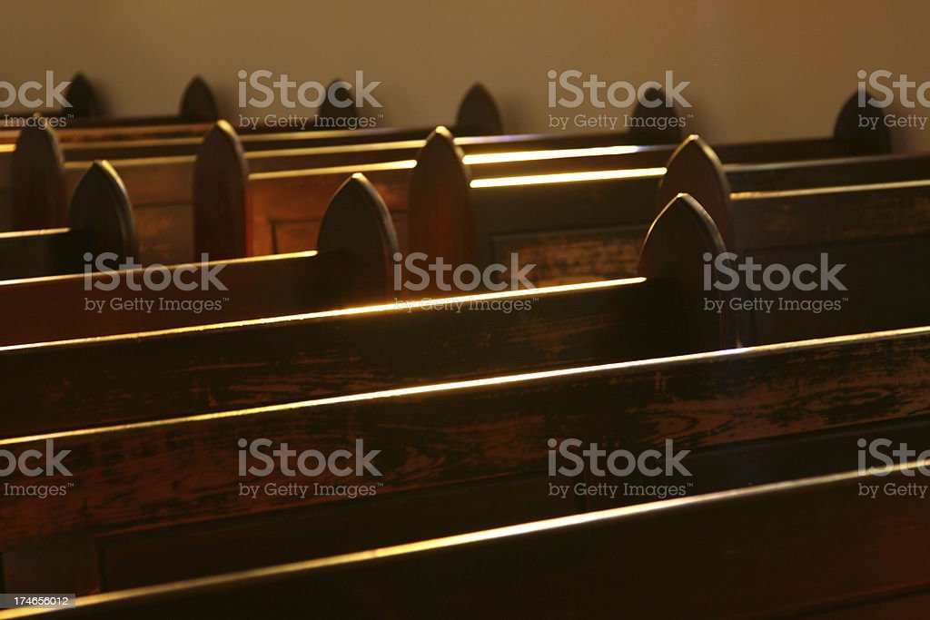 Rows of empty pew at a local church royalty-free stock photo