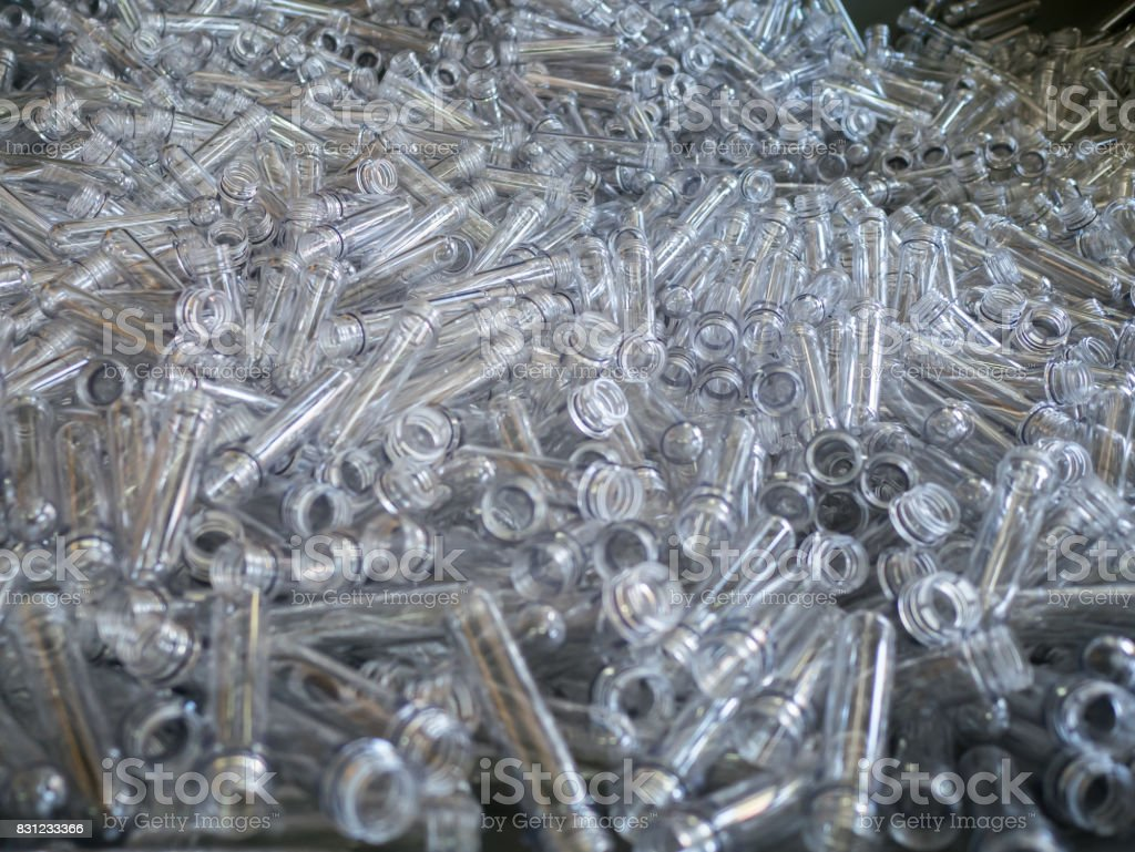 rows of empty plastic bottles at bottling plant. Production of small bottle line stock photo