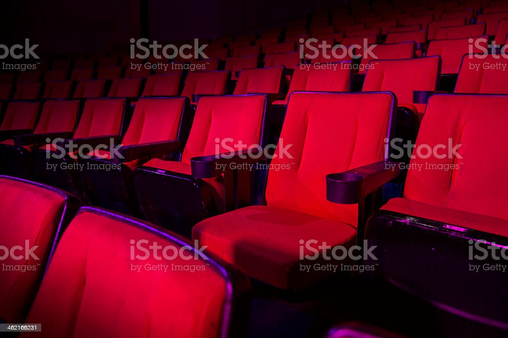 Rows of empty red theater seats stock photo