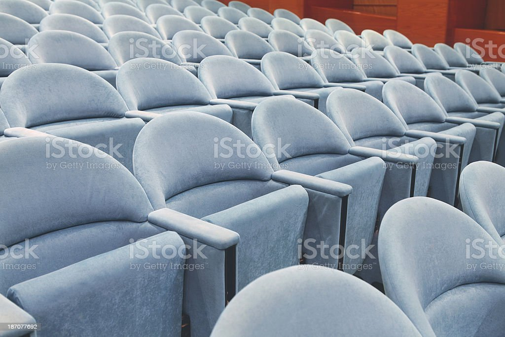 Rows of empty seats stock photo
