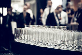 Rows of empty tall drinking glasses in bar
