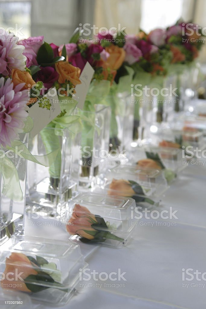 rows of flowers at a wedding stock photo