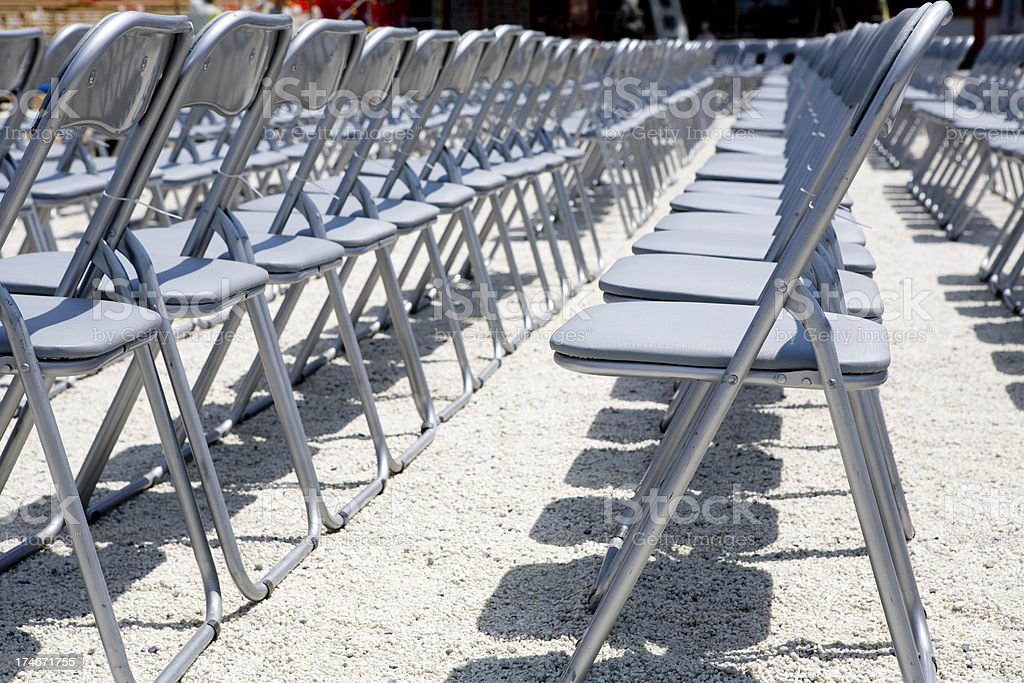 Rows of Folding Chairs stock photo