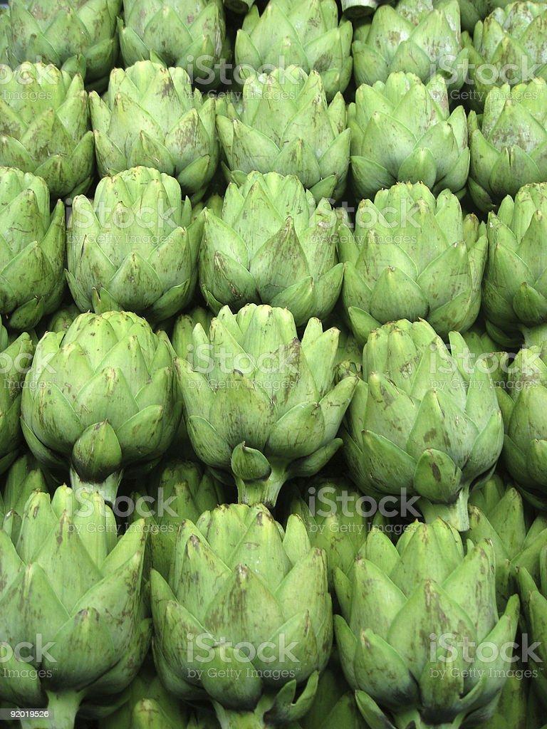 Rows of fresh green artichokes royalty-free stock photo