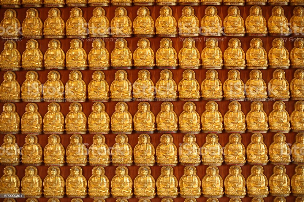 Rows Of Golden Buddha Statues stock photo