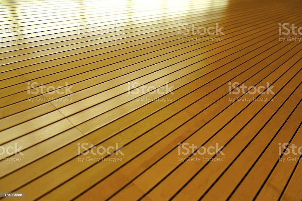 Rows of Golden Tightly Fitted Wooden Slats with Seam royalty-free stock photo