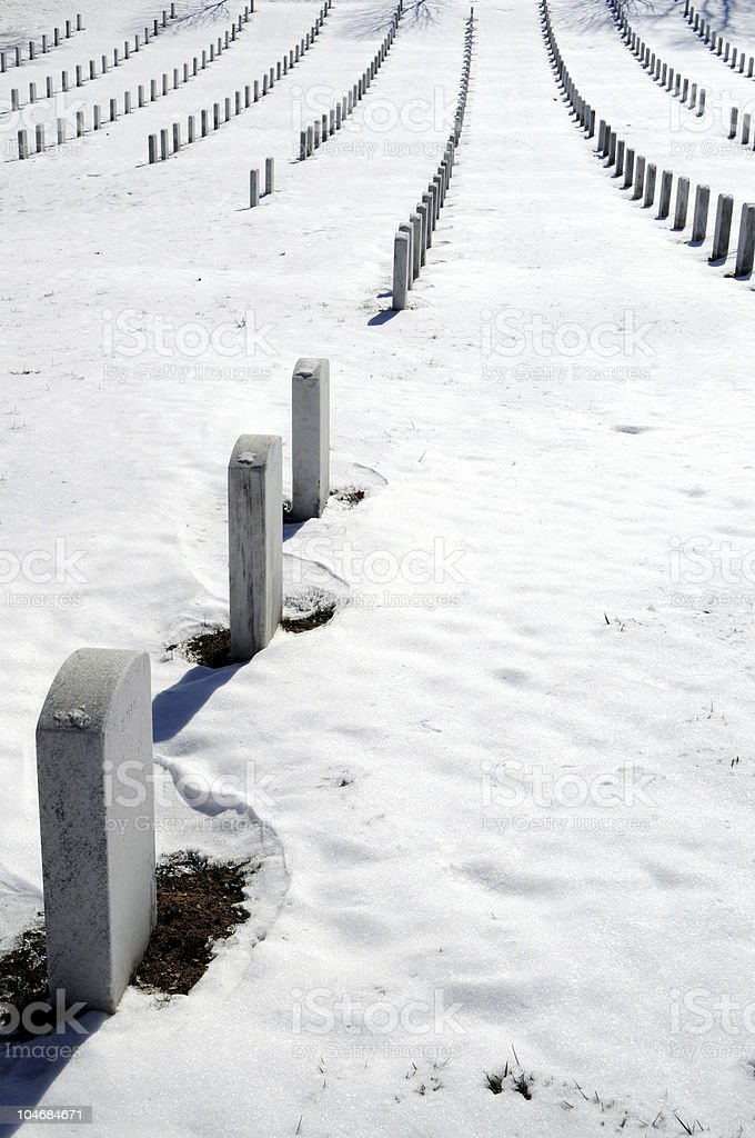 Rows of graves in winter royalty-free stock photo