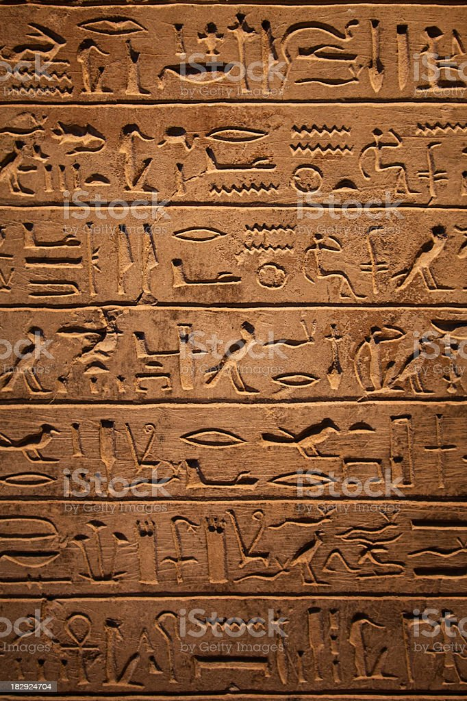 7 rows of hieroglyphics on wall stock photo