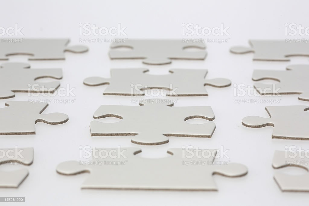 Rows of Jigsaw Puzzle Pieces royalty-free stock photo