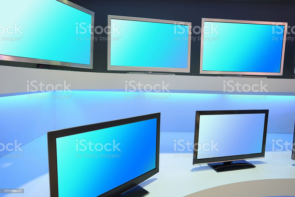 Rows of LCD TVs in TV Store stock photo