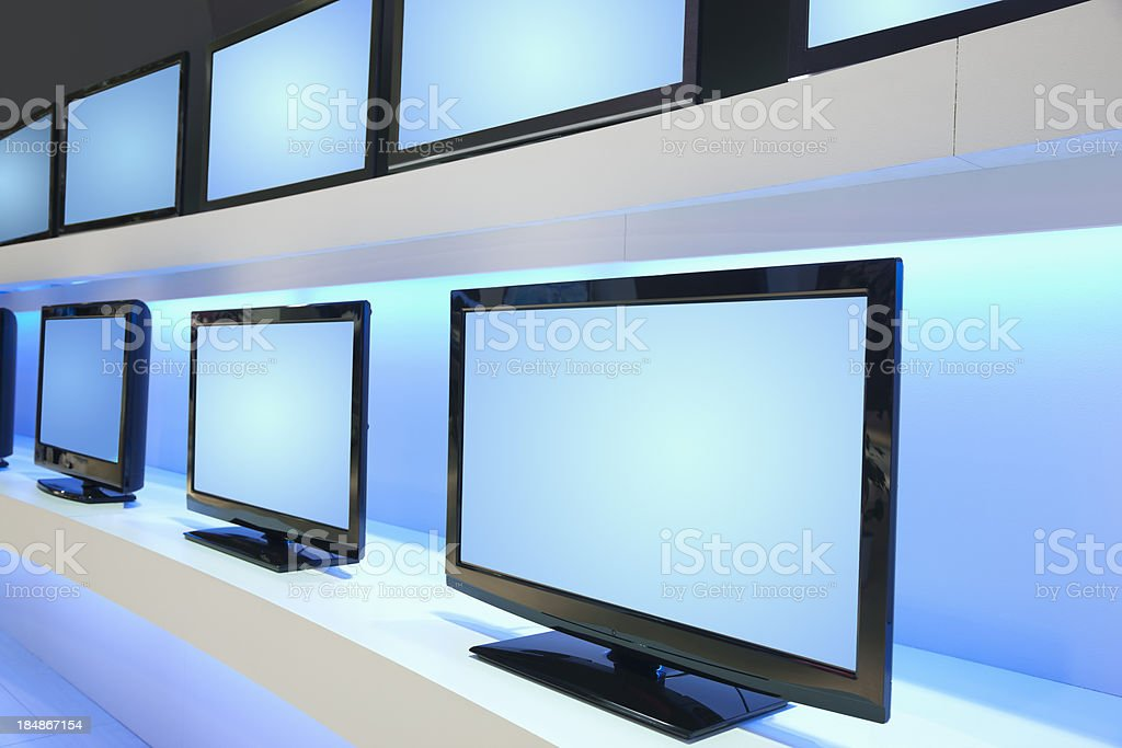 Rows of LCD TVs in TV Store royalty-free stock photo