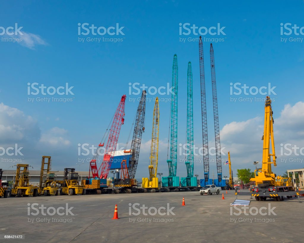 rows of many type of crane, crawler,mobile, truck, terrian stock photo