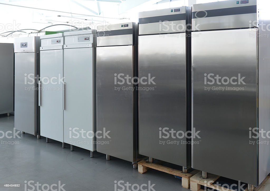 Rows of modern fridges in a store stock photo