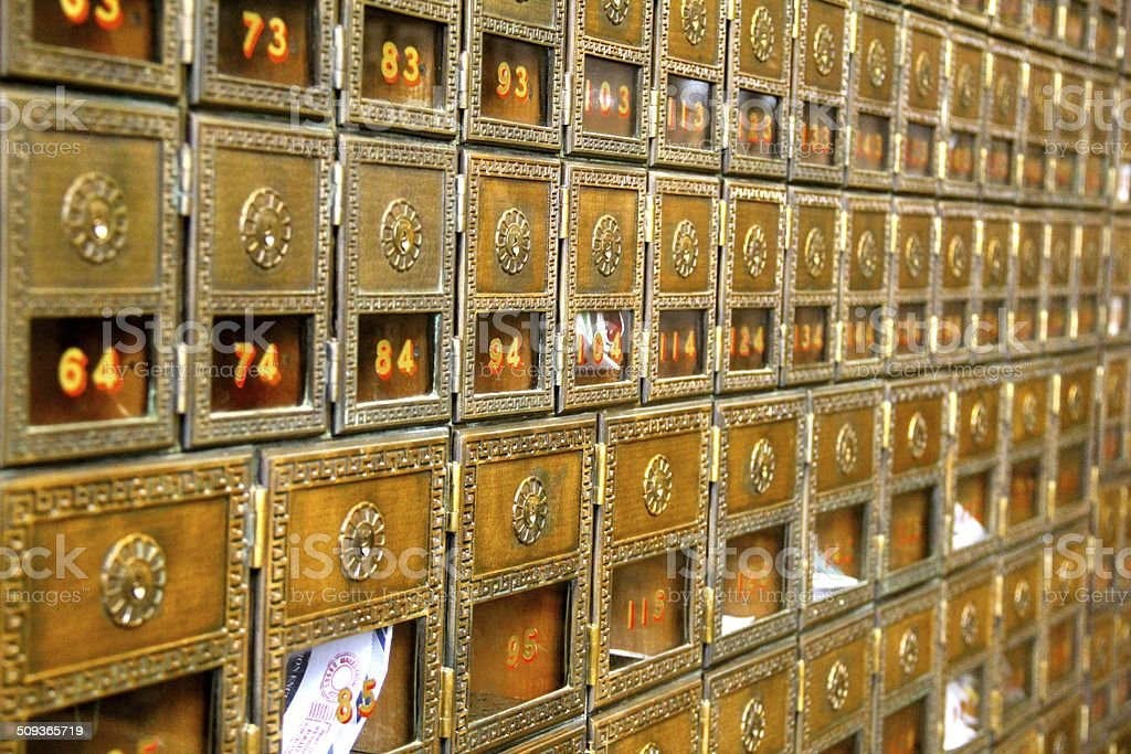 Rows of Old-World PO Boxes stock photo