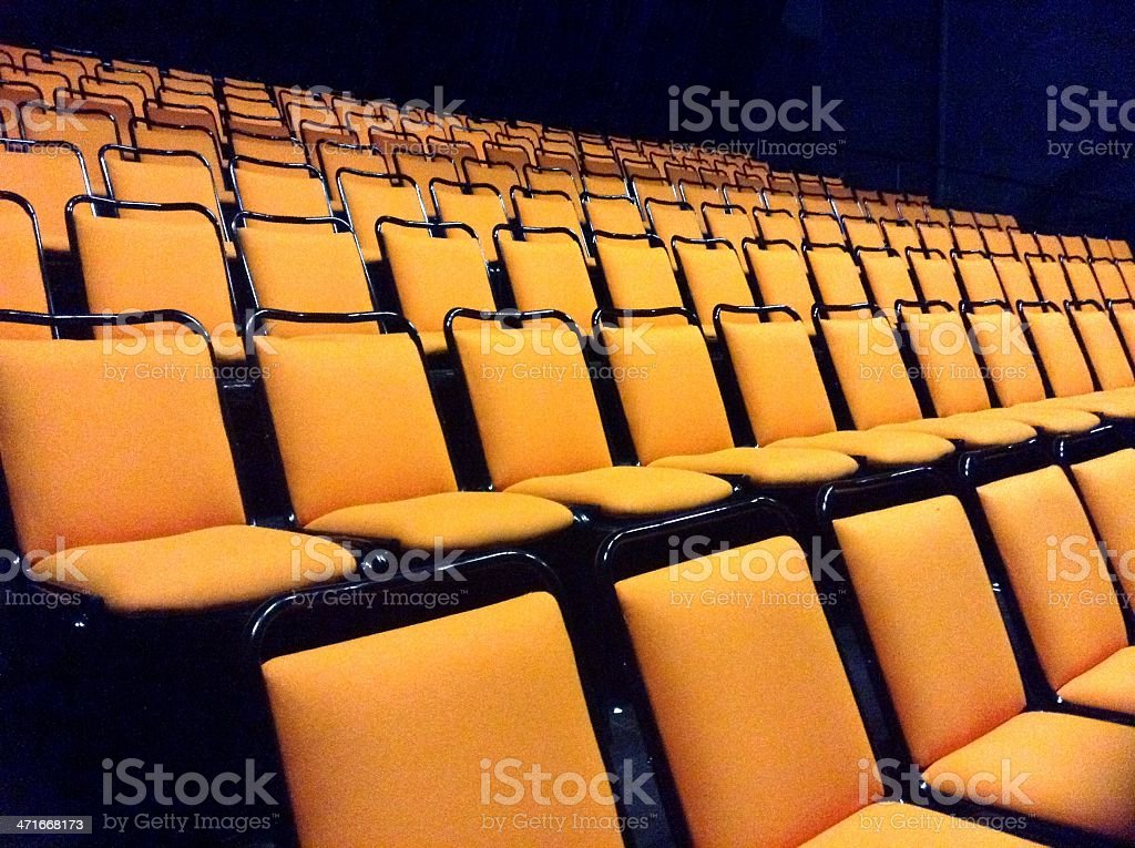 Rows of orange chairs royalty-free stock photo