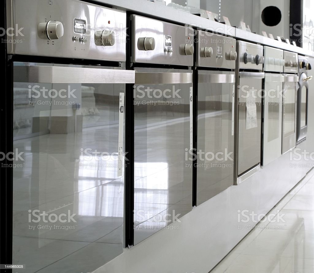Rows of ovens in a store royalty-free stock photo